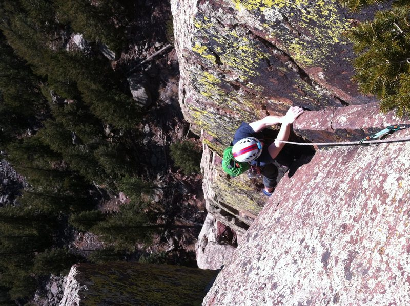 Eddie just finishing the crux moves of P3. Long John Wall, Eldorado Canyon SP, CO.