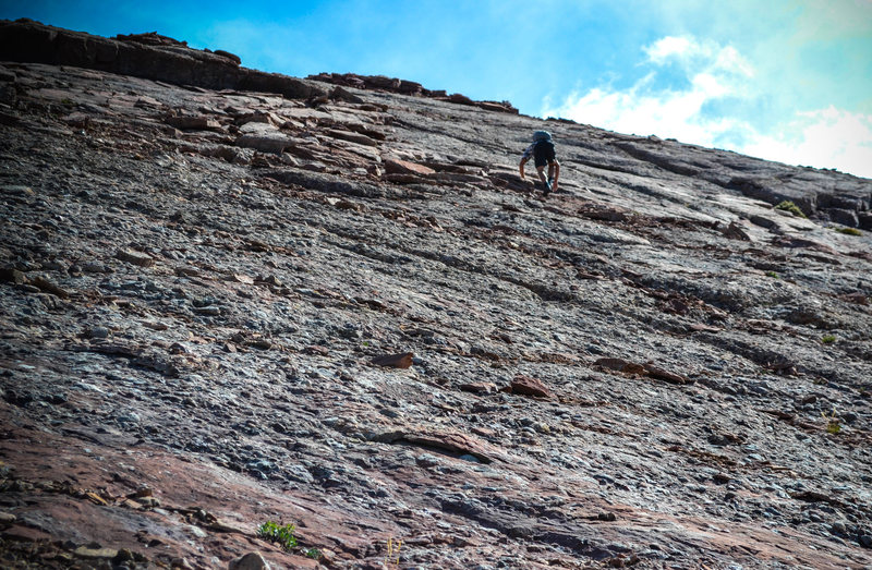 The last section of the face before gaining the summit ridge. Rock quality is deteriorating.