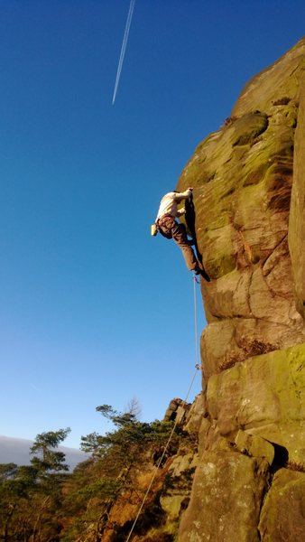 Grappling with the green slopers on Tower Face.