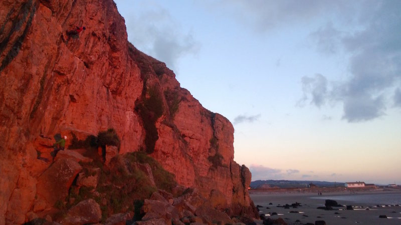 Brean in the evening light. A climber having one last go on Storm Warning Variation (5.13a/b)
