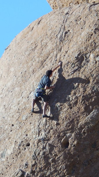 """A climber running laps on TR solo, on """"Boneyard."""""""