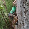 Zak Roper pulling the final crux moves of Touch and Go.