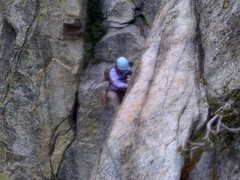 Sandra approaching the end of P2, then moving (climber's) right and down to the belay.