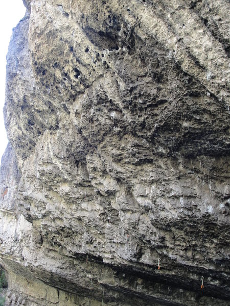 Top half of Trench Warfare- 13c.  Follows a left-trending flake/crack system into a faint dihedral below the chains.