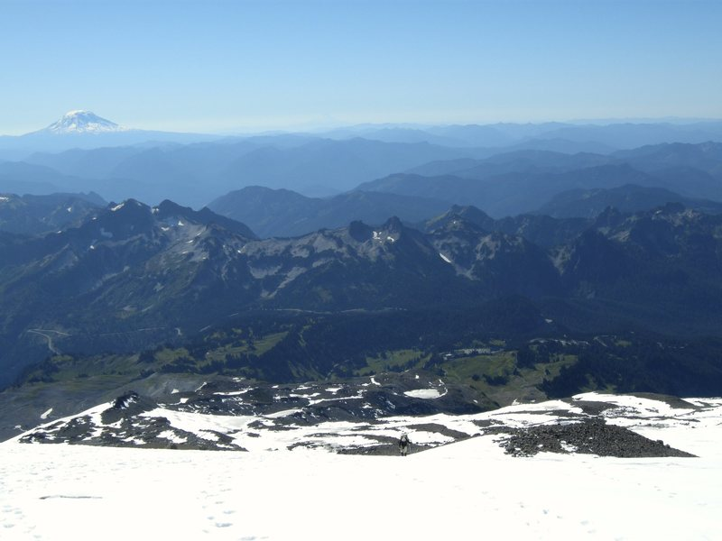 Castle, Pinnacle, and Plummer Peaks are in center of photo. Photo taken from Muir snowfield.