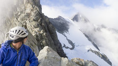 Scott Sampietro relaxing at the B-F Col bivy site with North Ridge in the background