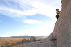 Rock Climbing Photo: Andy Patterson steps out onto the slabby finishing...