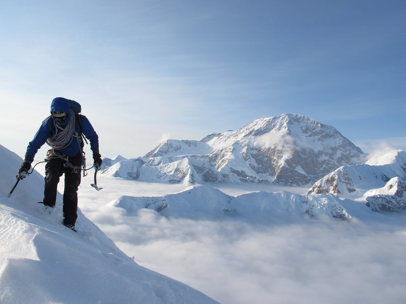 Vito pulling in to the Cornice Bivy at 12,700' with the monumental South Face of Denali behind him.