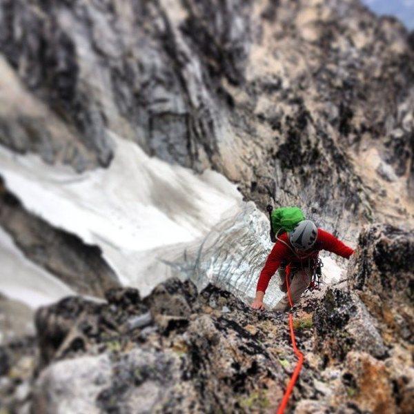 My brother Jimmy following a pitch on Serpentine Arete, Dragontail Peak, Enchantments, WA. Colchuck Glacier far below.