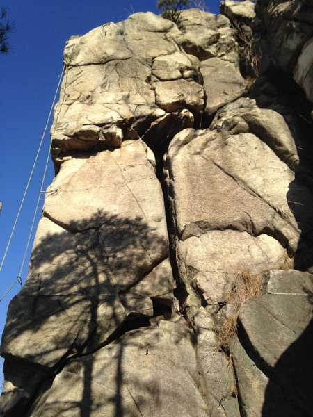 AC route in middle starting just left of large crack(with next route 'B' left with rope on corner)