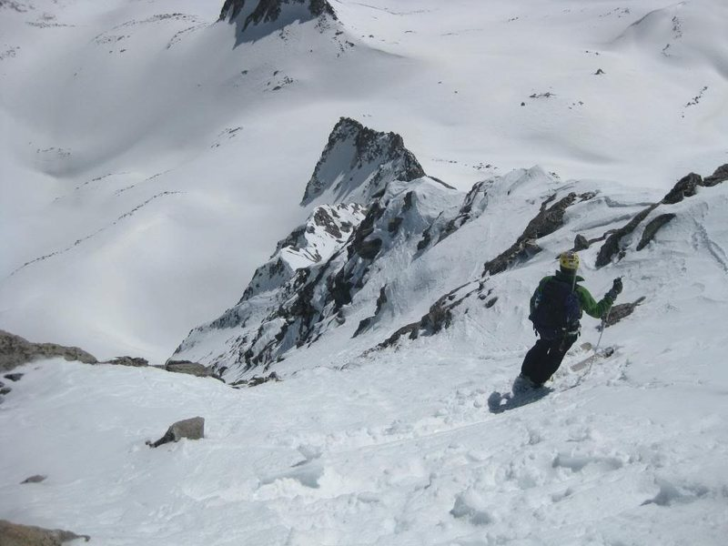 Moment of commitement - Jordan White in route to first winter ski descent of Cap - above the big cliffs - 2009.