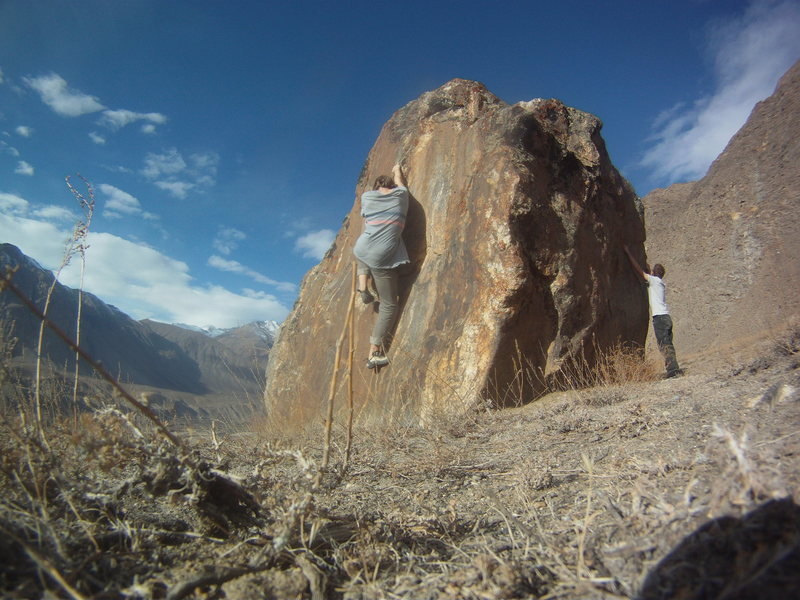 Climbing boulder in view of Afghanistan