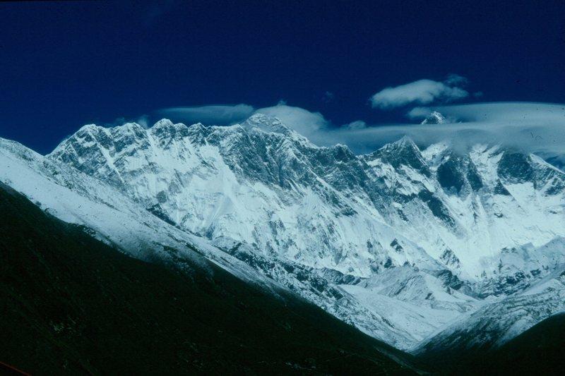 Mt. Everest (very top center of photo) from near the Tibetan Buddhist Monastery of Tengboche, part of the Sherpa community, Khumbu region of Nepal.