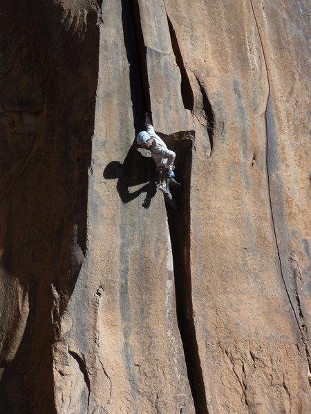 Aaron Miller exiting the crux roof on this excellent route.
