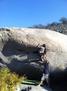Rock Climbing Photo: Felicia on the mantle move, feeling for the crimps...