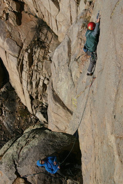 Zach Harrison getting into the crux on pitch 3 (rebolted) (Photo by Zach King)