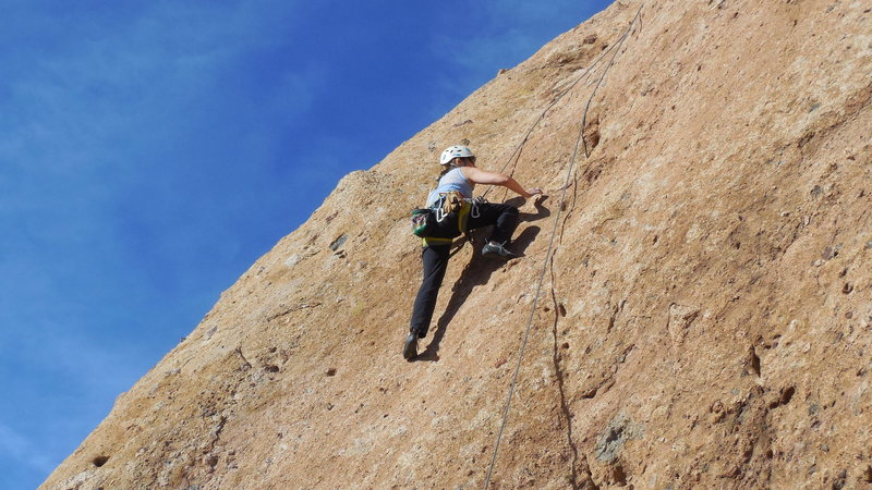 "Climbing the delicate upper slab of ""Don't Mess With Muleshoe."""