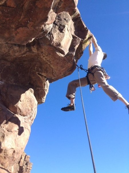 David Barton sticking the big move on Unknown Route, 11c/d.