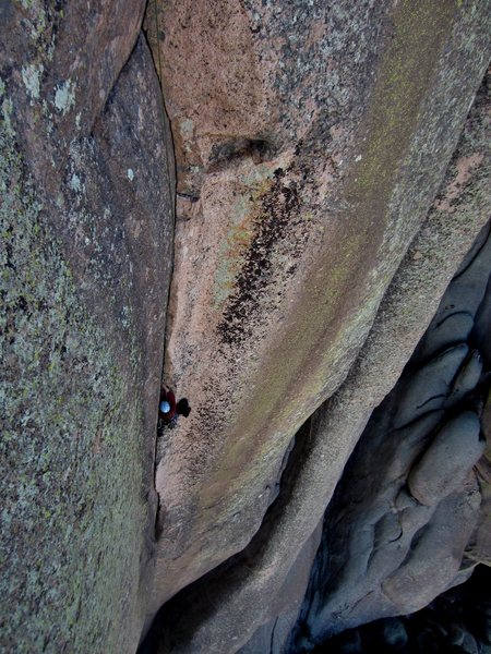 Tesia laybacking up to the crux