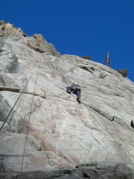 Jeroen climbs the line.  The rope above him nearly follows the upper bit.