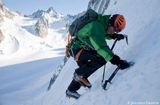 Jon Griffith photo of Ueli Steck soloing the Ginat.