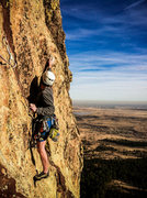 Rock Climbing Photo: Eddie crimping high over Boulder on the exposed th...