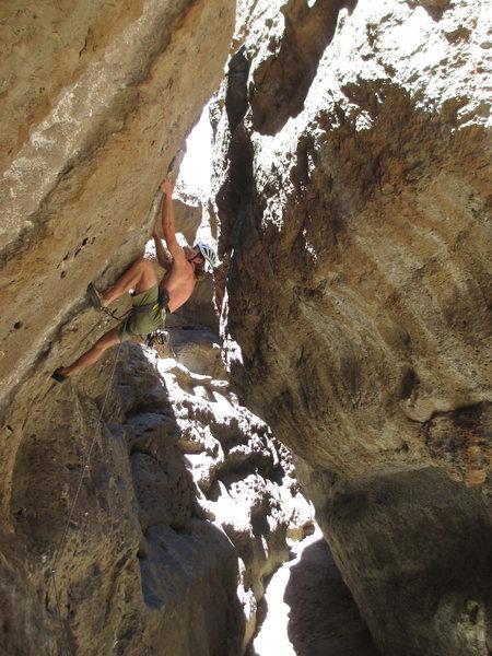Bill Bjornstad climbing a steep 5.10+/11-