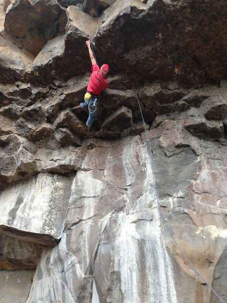 Kevin starting the upper crux of Dark Night