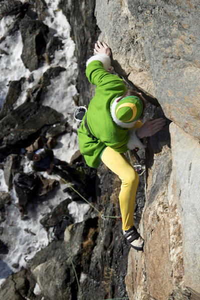 Buddy the elf mantels out of the crux corner...<br> photo: kevin Macartney