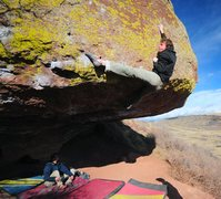First move of the topout on Bambi, V11/V12.