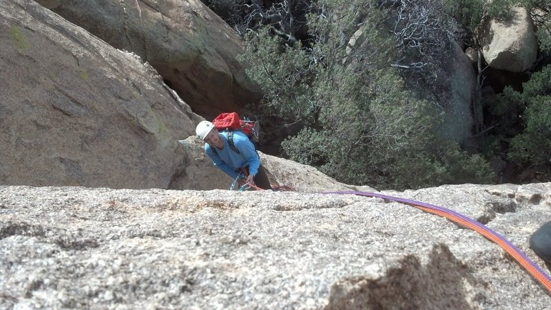 Looking back at the belay station while leading the second pitch.