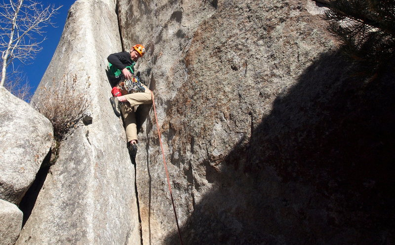 Garret climbing the opening dihedral/hand crack