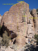 Pocket Route (Yellow) is the middle climb of the rock face. <br /> <br />Lefts Side: A day in the life of Rommstein to the left (Blue) <br /> <br />Right Side: Renacuajo 5.11a (Green) <br /> <br />Mustache Mayhem is just around the corner. (orange)