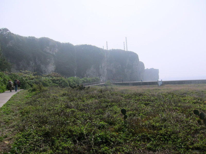 The beach and the sea cliffs beyond