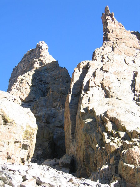 Another photo showing the base of the route, as well as the prominent dihedral of the Davis-Fowler.  Sharkstooth on the left, Petit Grepon on the right.