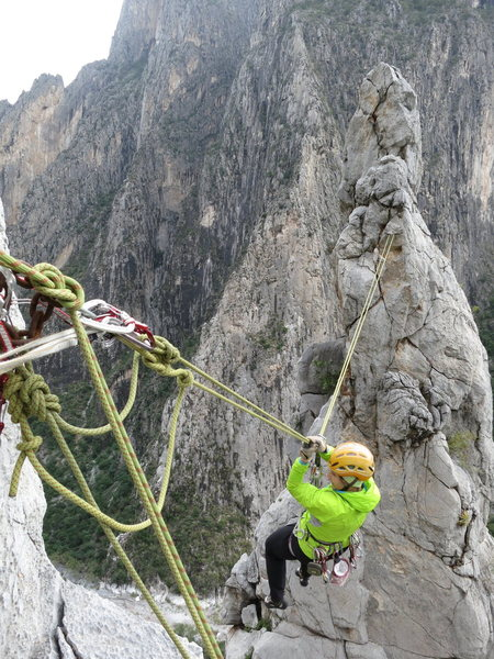 """Lucie on the Tyrolean traverse from the eastern needle (Aguja Grande, after climbing """"Off the Notch"""" 5.10) back to the top of """"Aguja Celo Rey"""" on the Aguja Chica."""