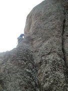 Rock Climbing Photo: Noal just past the two pitons on top of the small ...