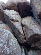 Rock Climbing Photo: The route goes through the crack in the large boul...