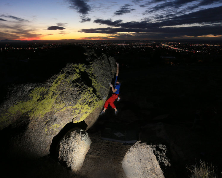 Bouldering against the Abq city lights at sunset.<br> <br> Climbing: Jarred Cleerdin<br> Photo By: Jeremy Gallegos