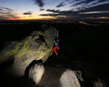 Bouldering against the Abq city lights at sunset. <br /> <br />Climbing: Jarred Cleerdin <br />Photo By: Jeremy Gallegos