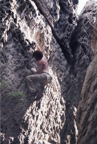 30 foot highball.  The beginning face is a sequential V2 split by a sandy horizontal break at mid height then an easier finish (5.9) on a sugary vertical wall.