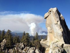 Rock Climbing Photo: Hermit Spire summit block with a January wildfire ...