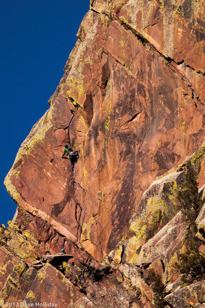 Unknown climber leading the crux pitch.