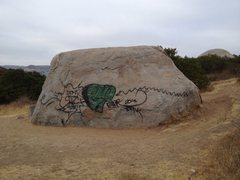 This boulder was once a great warm up. Who knows who tagged it, but it was a bummer when I got to this side of the traverse. <br /> <br />I hope flyers like above don't increase the photos like this. Taken close to SDSU, but I hope a student isn't the culprit <br /> <br />Paint buildings not rocks