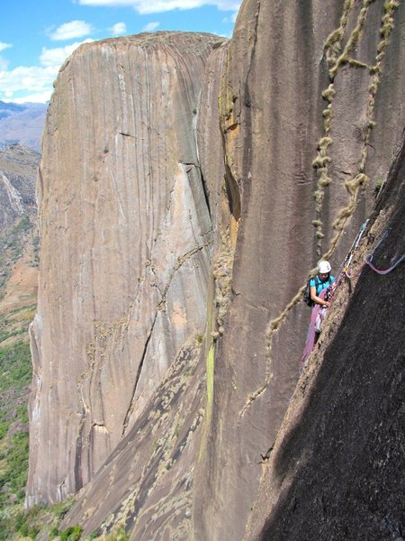 Madagascar.  Pitch 5 of Pectorine on Lemur Wall with the beautiful Karambony Pillar in the background.