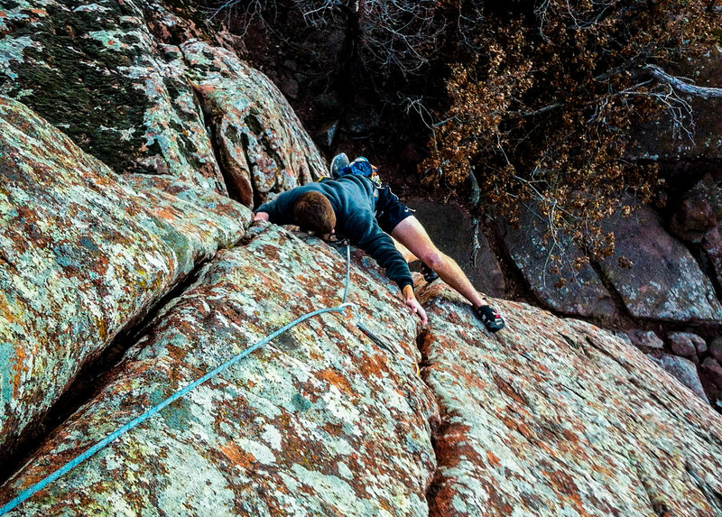 """Nate working the moves through the odd roof crux of """"Mr. Green Slings"""". WWR, OK."""