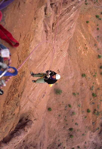 Chip jumaring on pitch 5. A storm rolled across from the La Sals, with lightning and much wind.