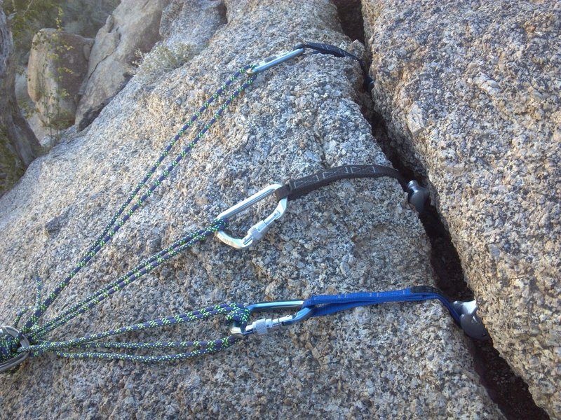 TR gear anchor at the top left of the route. Three tricams. There are other placements further right with either large cams or a few lengths of webbing to sling and extend the masterpoint.