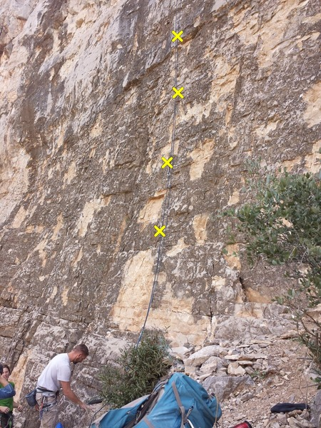 Start of climb as seen from the trail. Blue rope in the picture shows the bolt line.