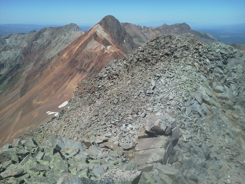 Looking west at Mears Peak from S6. Ruffner left, Peak 13,134 (S9) on the far right. Broken rock. The red on Mears is especially bad and presents a challenge.